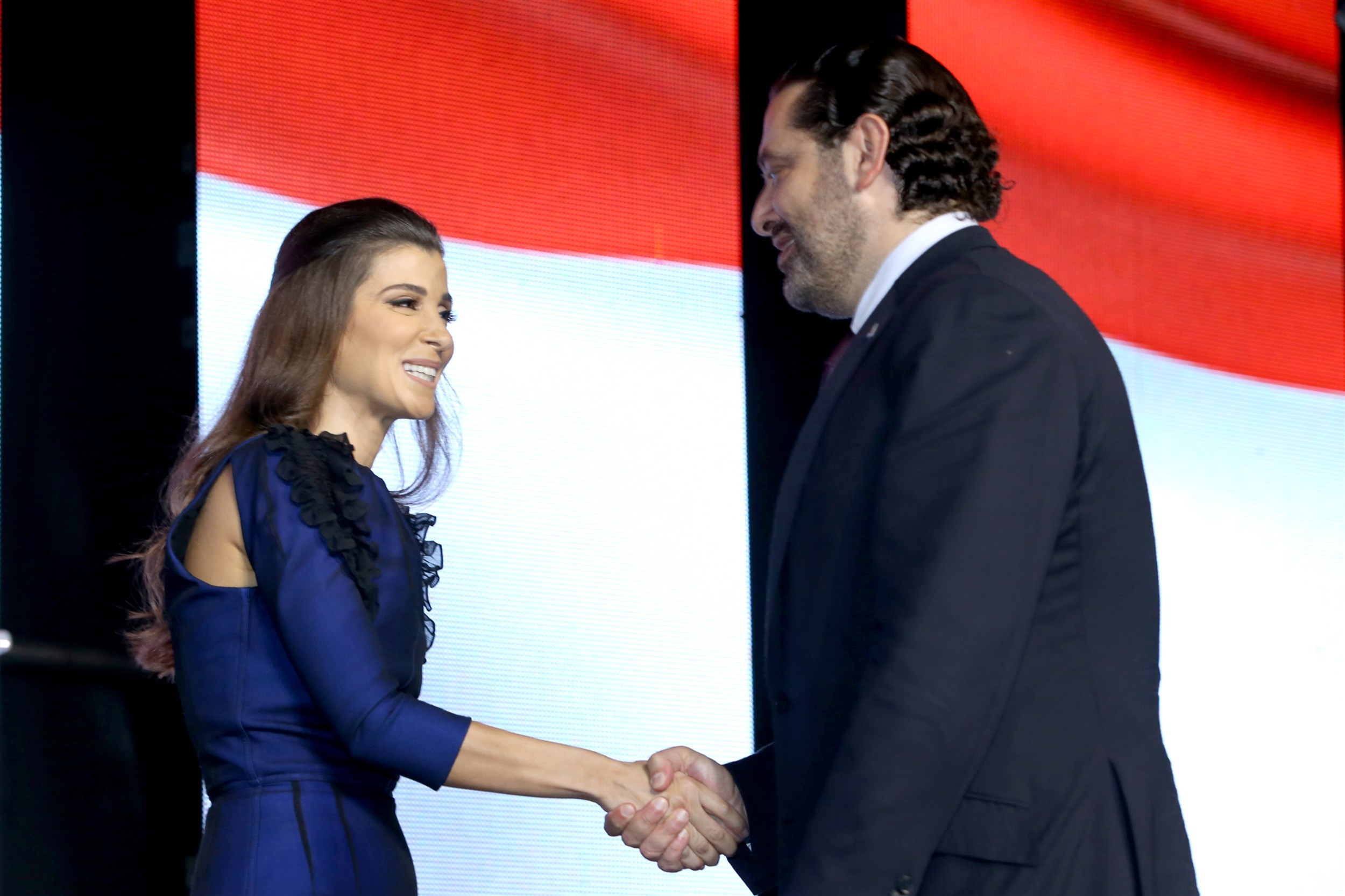 iaaf president with his excellency prime minister saad hariri as she delivers the stage for his speech.