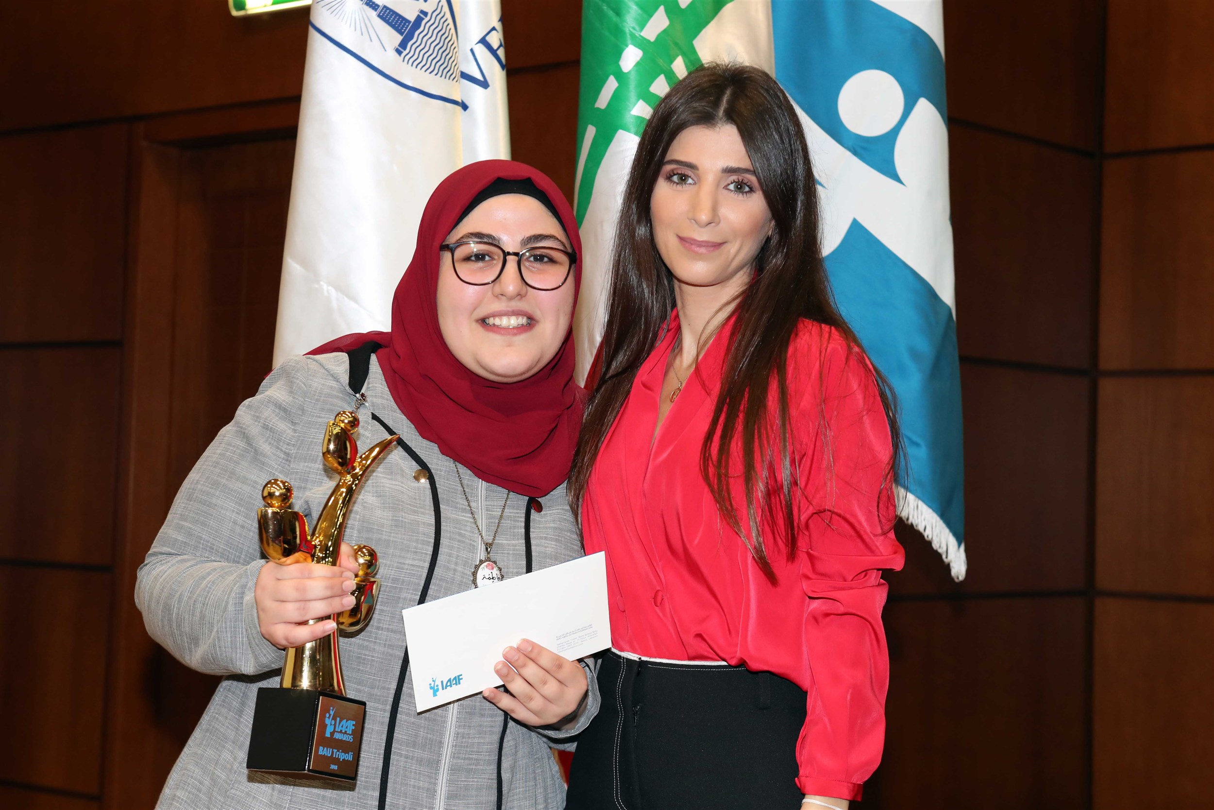 the  winning  student  fatima  al-fawal,  from  the  faculty  of  science-  mathematics  and computer science department a picture with mrs. inas al jarmakani.