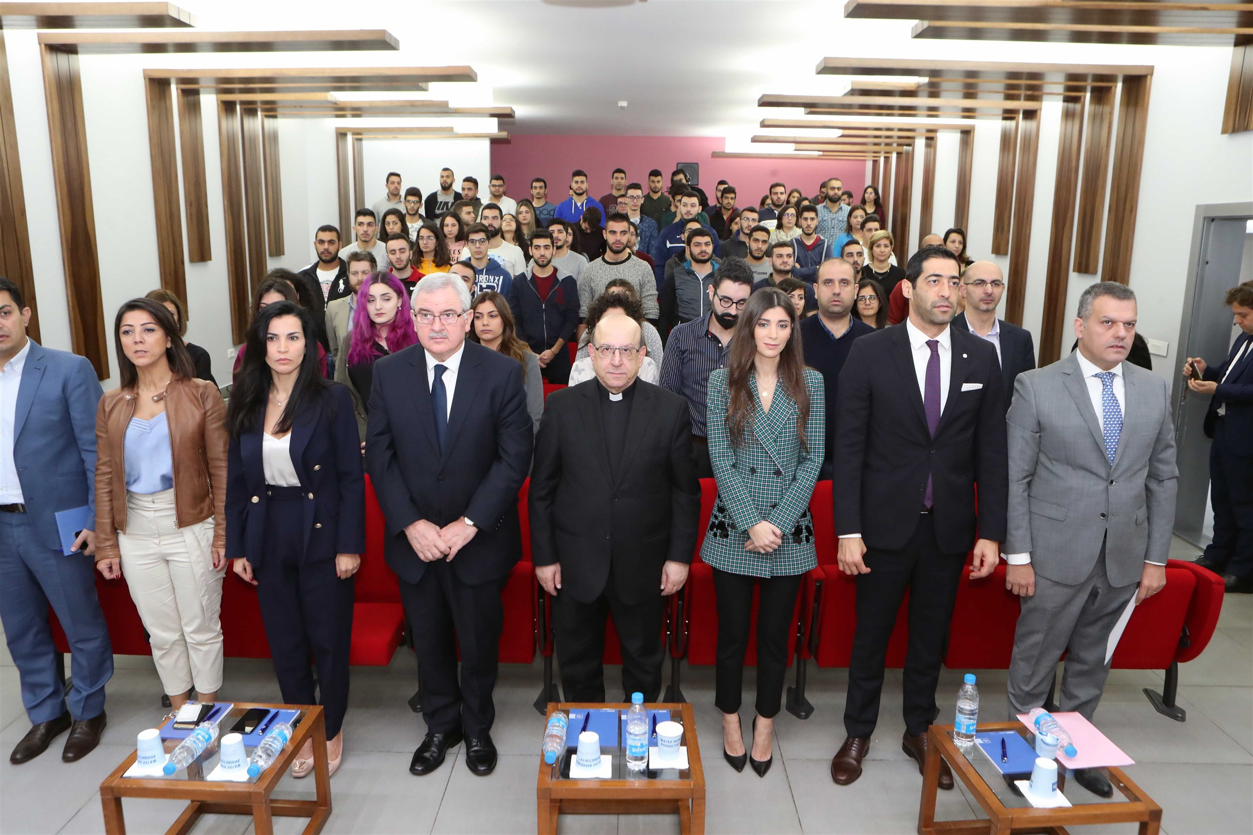 president of usek father professor georges hobeika, mrs inas jarmakani, minister jean oghassapian, member of parliament elias hankash, mr. elias abou fadel, head of the department of science and technology dr. barbar zeghondi stand for the lebanese national anthem.