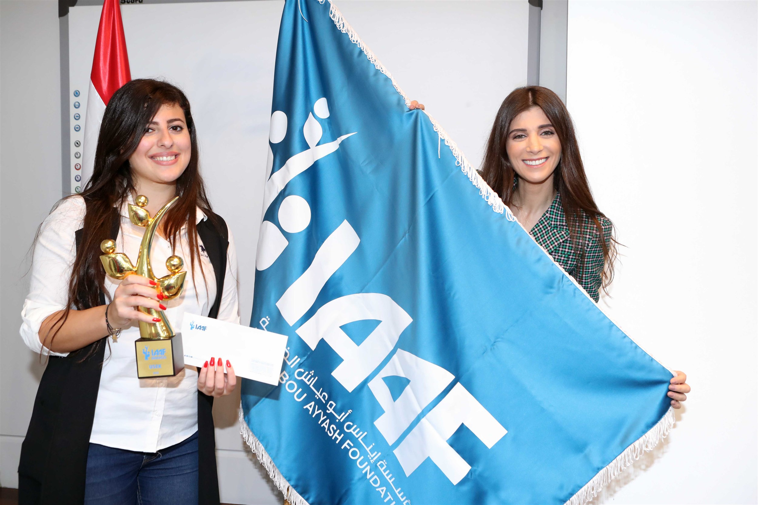 the winner of the  holy spitiy univesity of kaslik  sarah abi abdallah delivering her prize and trophy, because she dared to dream!