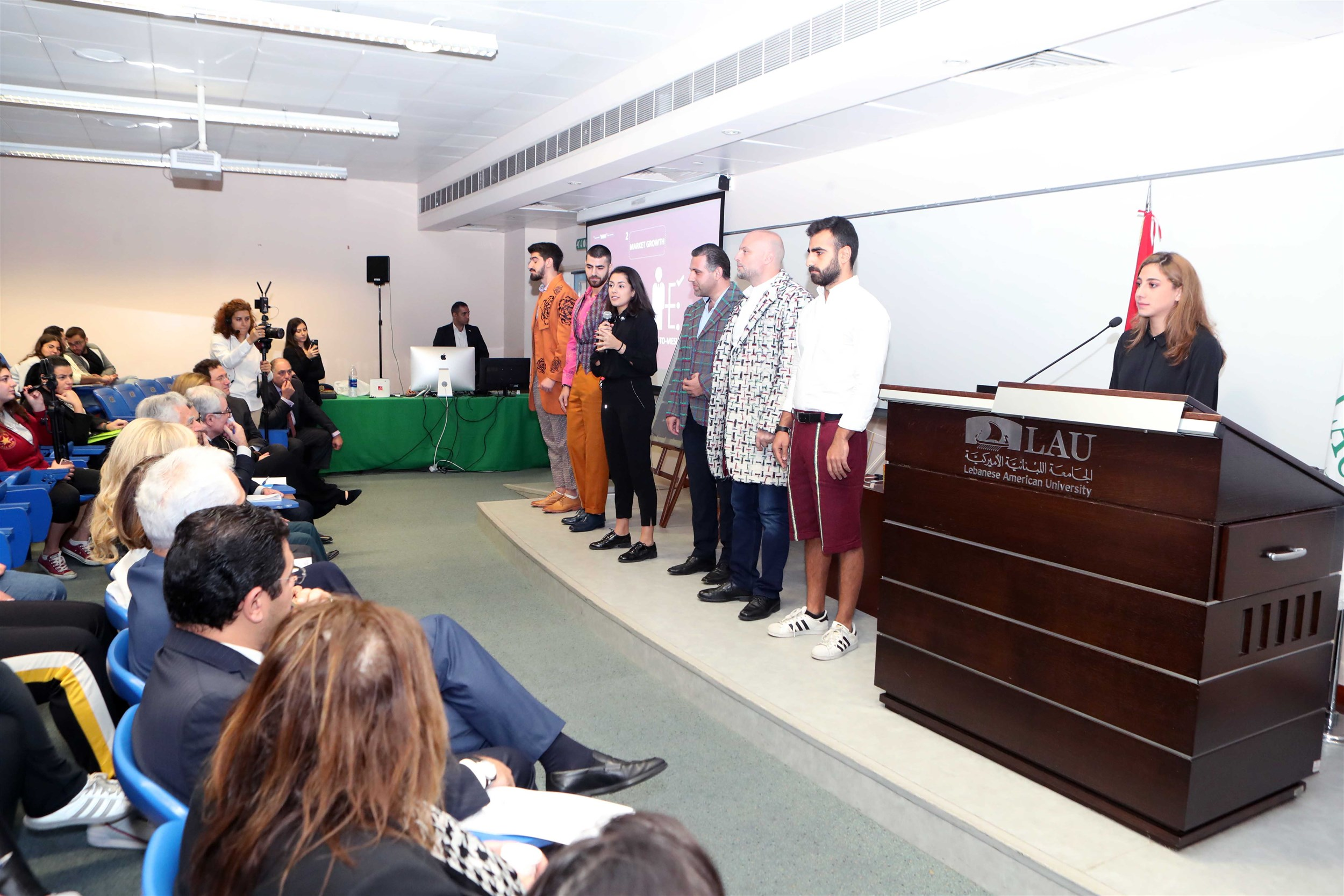 the winners of the beirut campus iaaf awards presenting their project that empowers people with special needs through providing them with job opportunities and teaching them handmade clothing that challenges traditional wear titled lmn