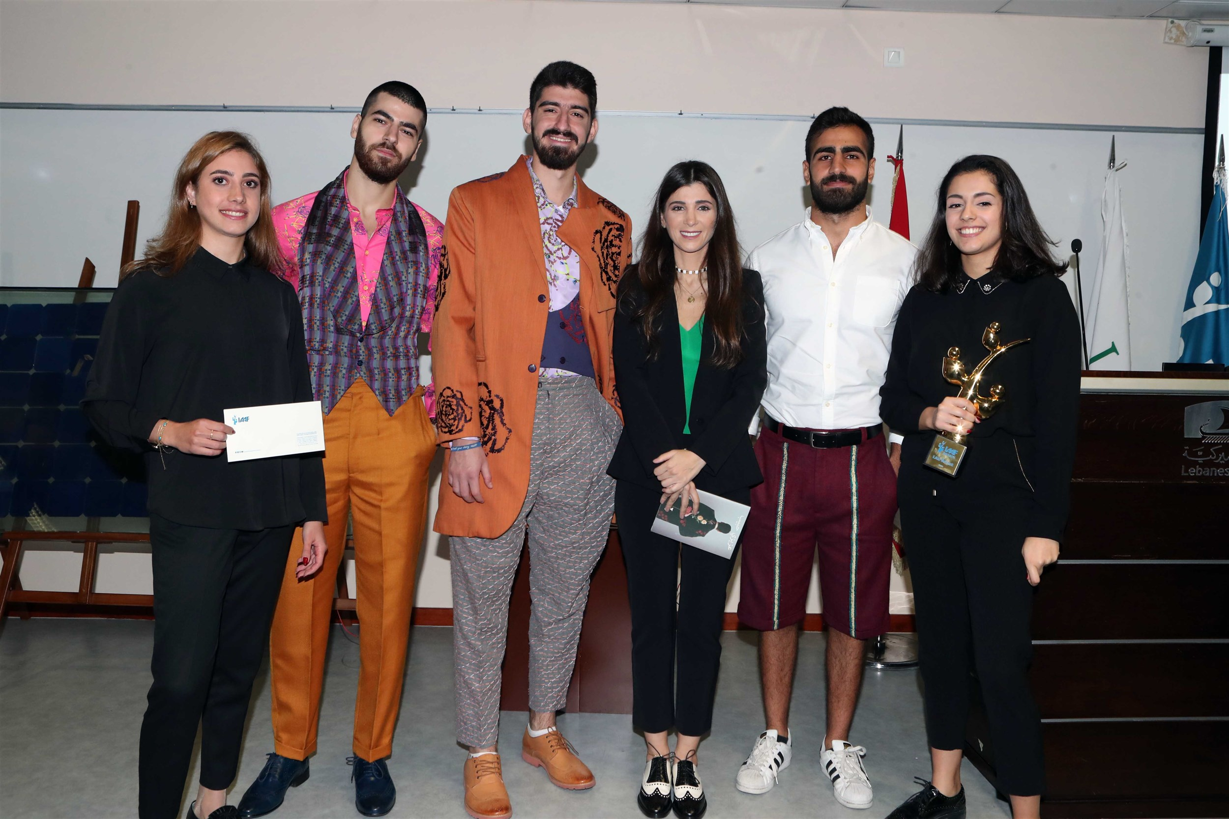 """the winners of the beirut campus iaaf awards claiming their trophy for their project """"lmn""""."""