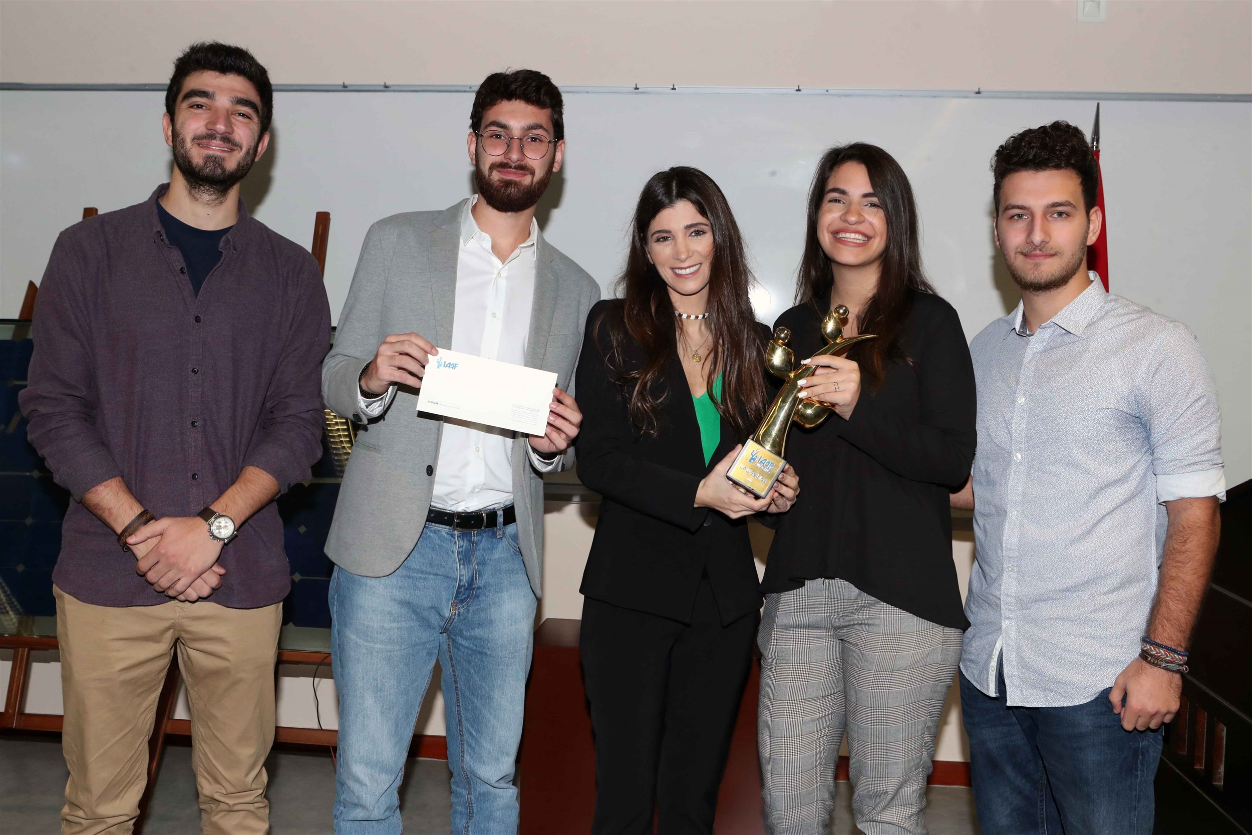 """the winners of the byblos campus iaaf awards photo with mrs. inas al jarmakani after receiving their monetary prize for their project """"findmydoc"""""""