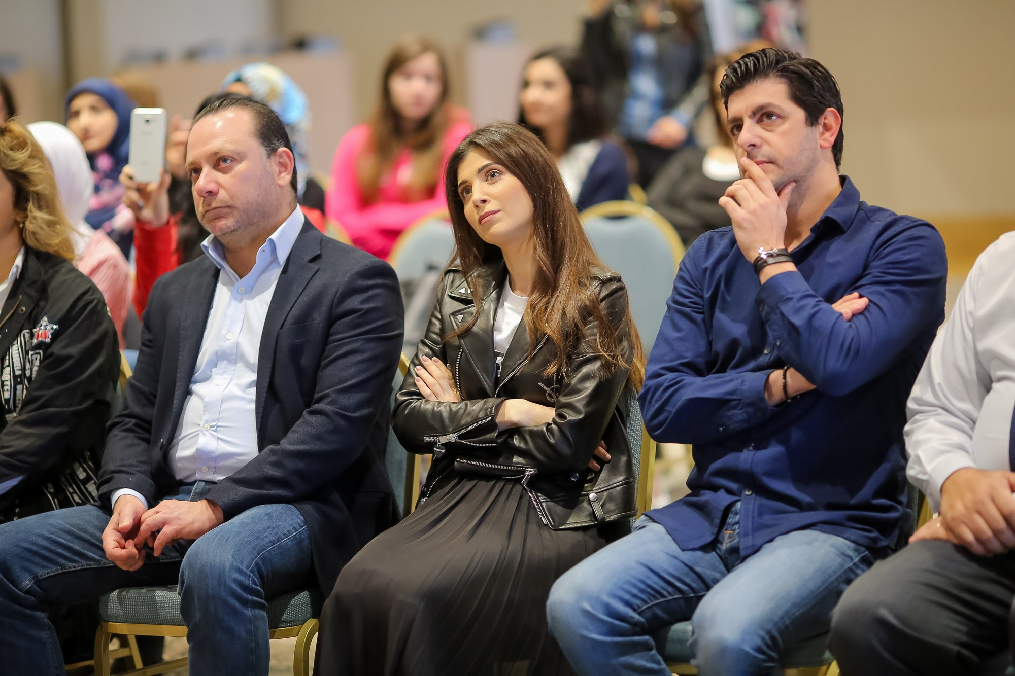 mrs. inas al jarmakani and celebrity guest speakers news host bassam abou zeid, actor tony issa participating in an event to urge lau students to participate in the iaaf awards and not shy away from their dreams.