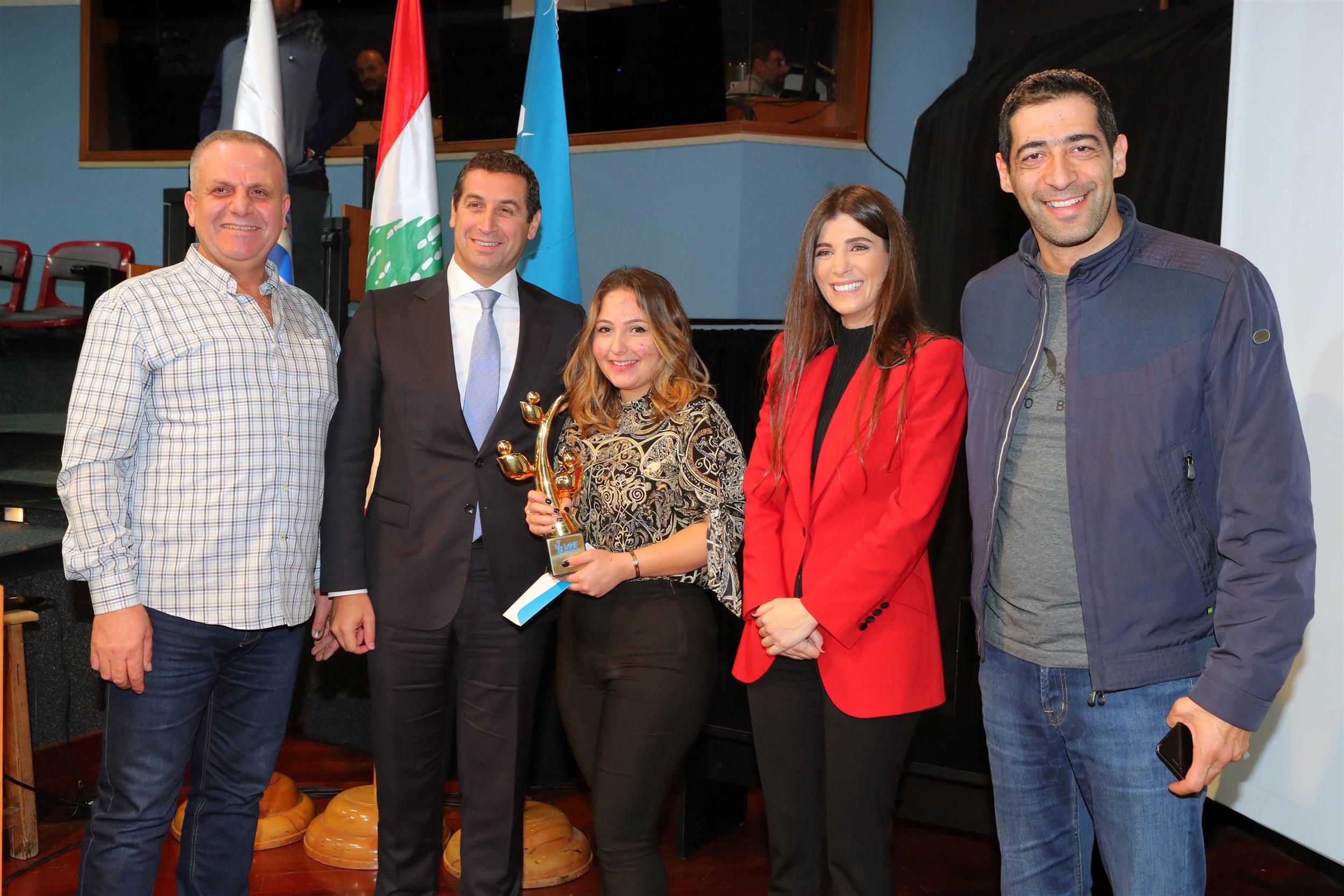 "members  of  the  parliament  mr.  elias  hankach  and  mr. eddy  maalouf with  mrs.  inas  al jarmakani and winner tia wakim for her project ""pharma lebanon""."