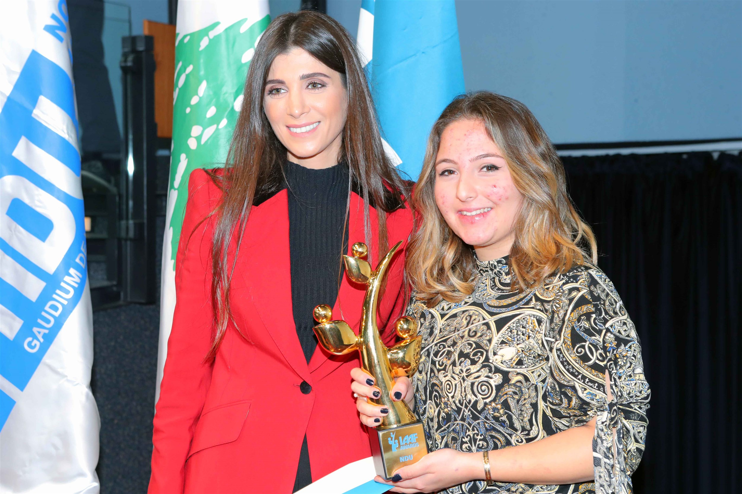 """mrs inas al jarmakani with the winning student tia wakim after receiving her trophy for her project titled """"pharma lebanon"""", an app which will help keep track of all pharmaceuticals in lebanon, their quality and availability."""