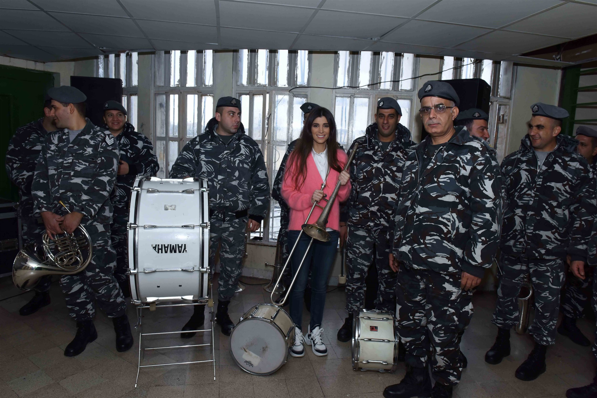the founder and president of the iaaf mrs. inas al jarmakani with the lebanese army orchestra.