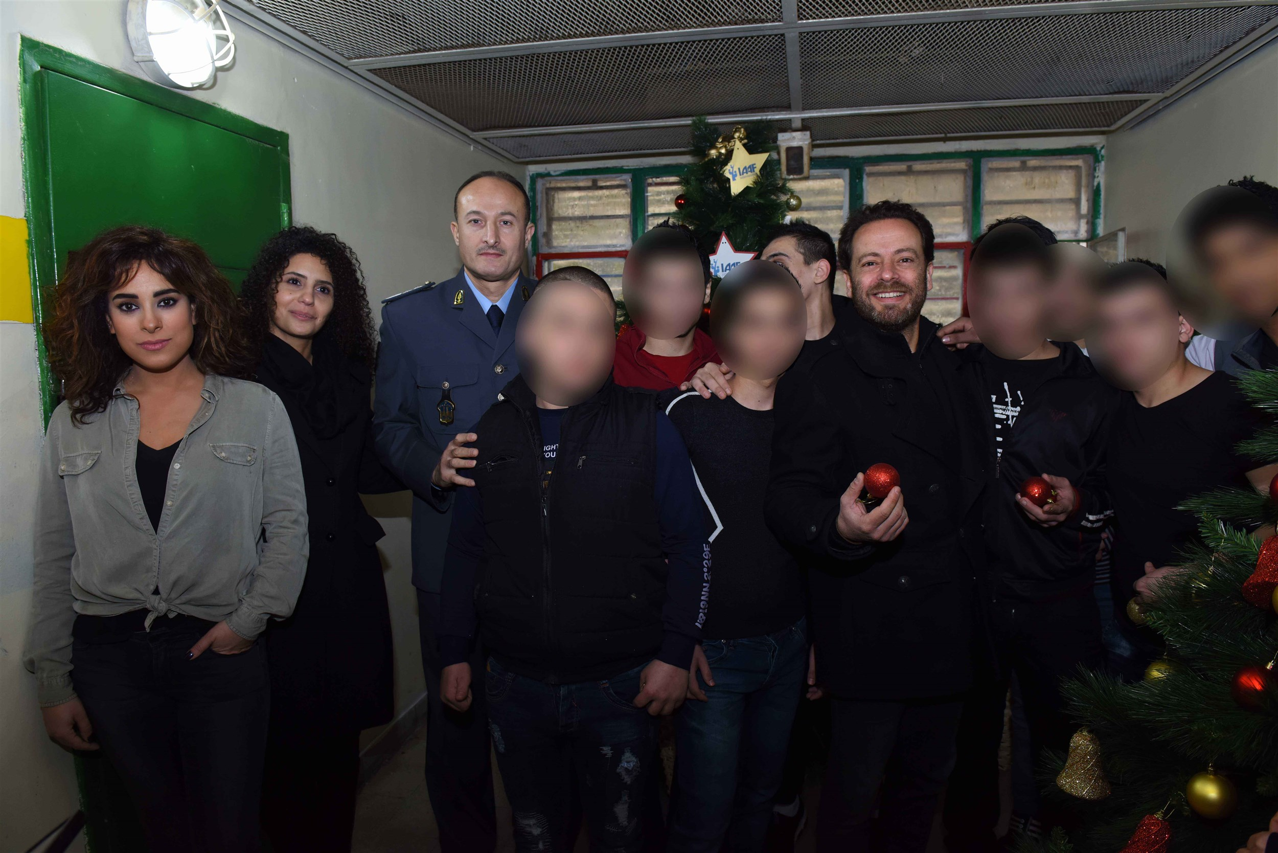 army officials and celebrities sharing a rare picture with the inmates of roumieh prison in the spirit of the holy season.