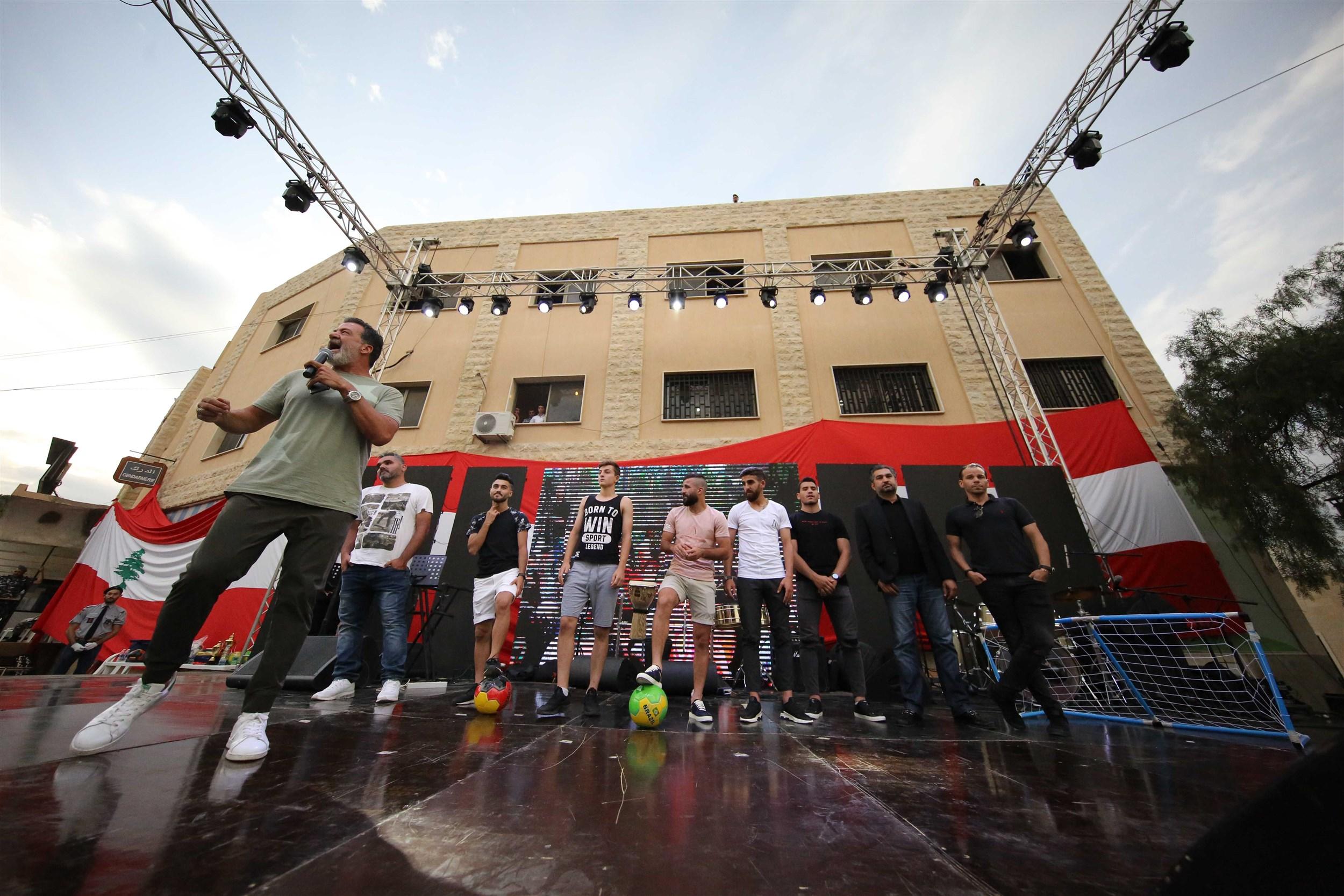 """host tony baroud introduces on stage members of """"el nejmeh"""" football team."""