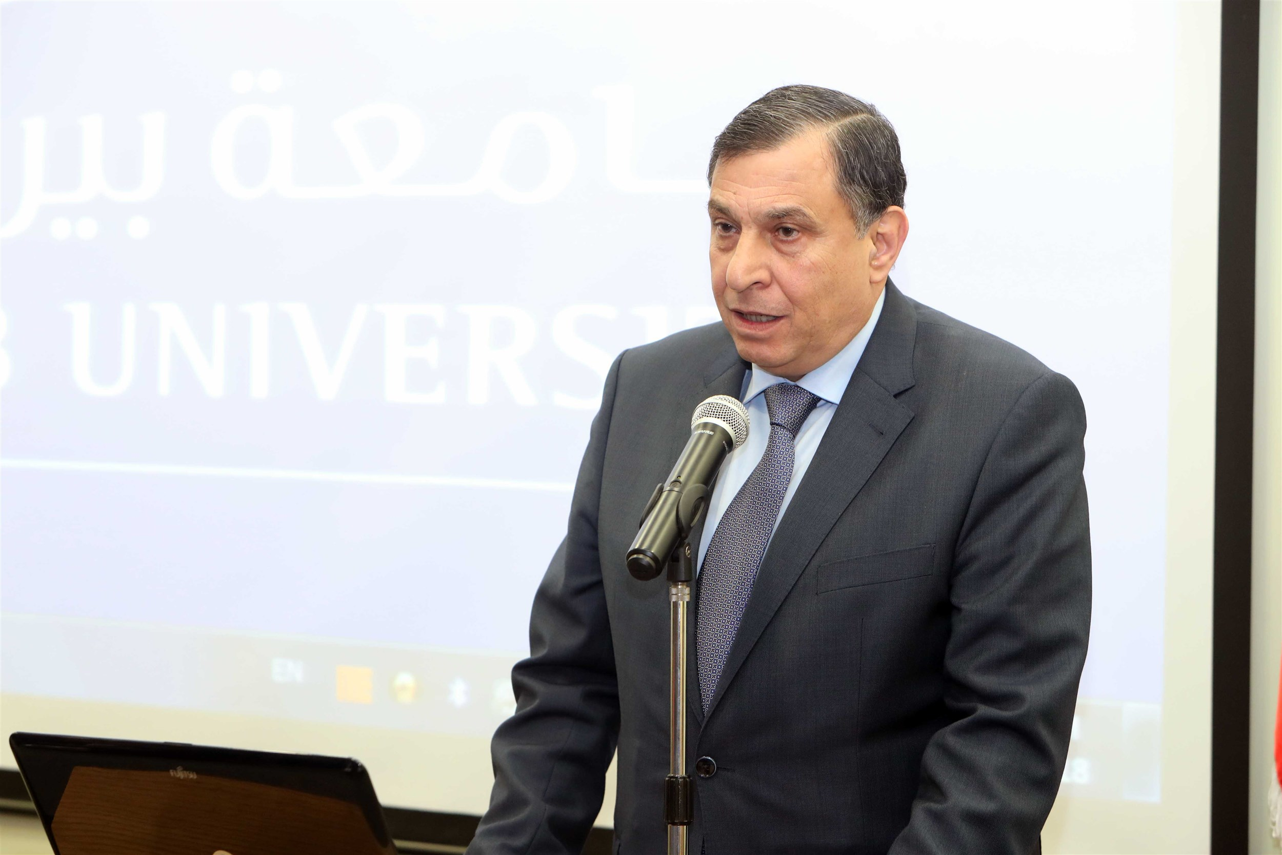 president of the beirut arab university dr. amro al adawi delivering his speech.