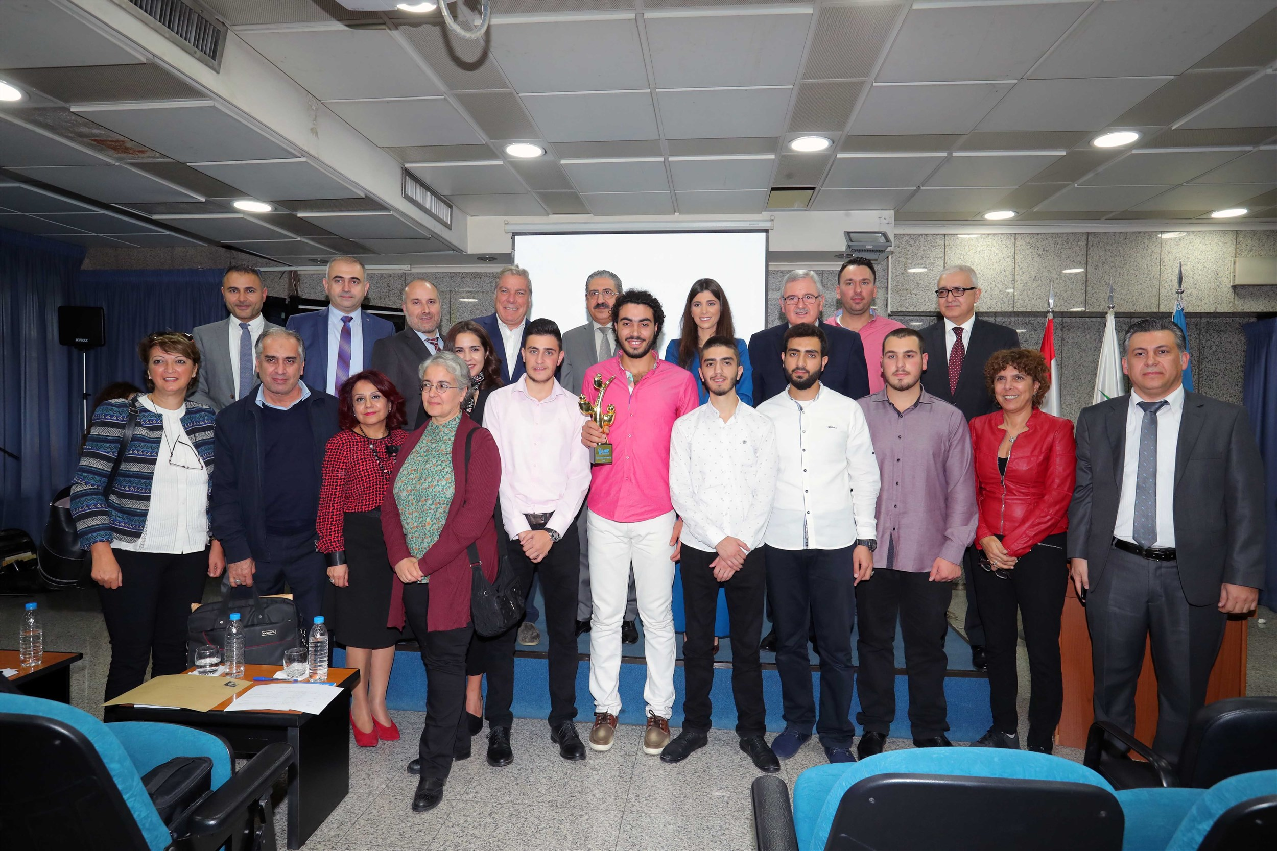 the students of the lebanese university who participated in iaaf awards with the president of the lebanese university professor fouad ayoub and the jury.